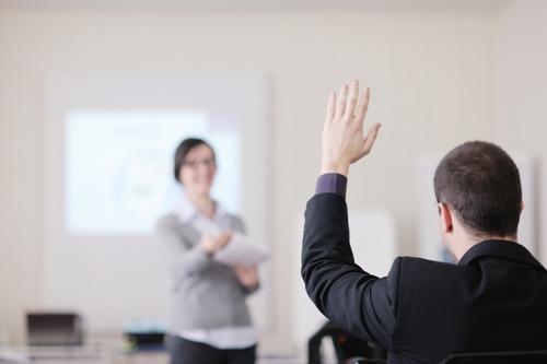 training-raising-hand